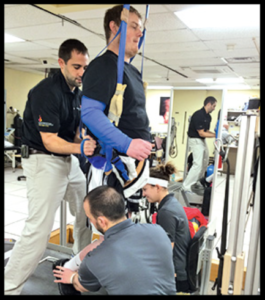 Ohio State University Wexner Medical Center NeuroRecovery Network patient on bodyweight-supported treadmill training.